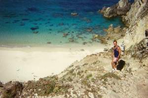 Rog climbing down to Trezien Beach