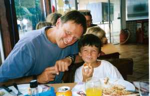 Grandad and Harry eating pizza in Leon
