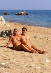 Quee and Cliff on secluded beach