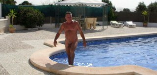 Ian in Alicante Nudists swimming pool