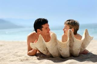Naturist couple on a shell