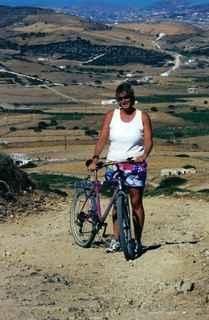 Jan with bike on hilly Antiparos